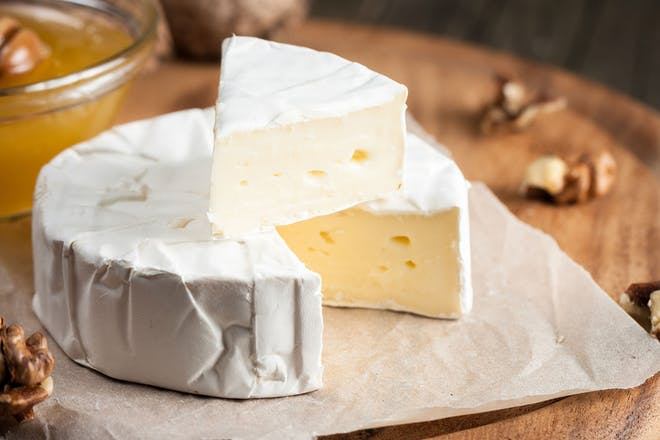 round brie cheese with slice cut out