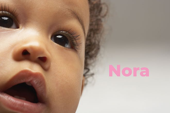 Close up of baby's face. Name Nora written in text