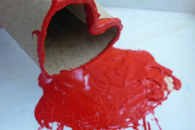 red paint on toilet roll shaped heart
