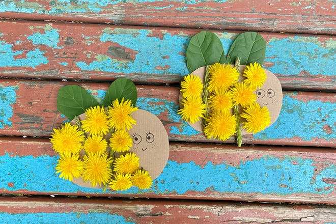 Cardboard bees with dandelions stuck on and leaves for wings