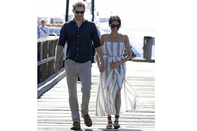 Prince Harry and Meghan Markle walking on beach