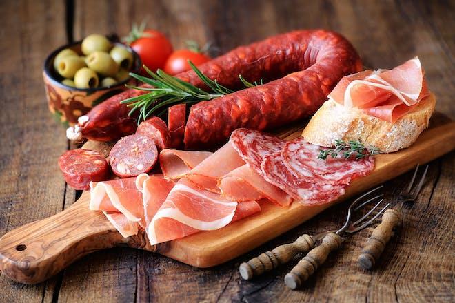 Cured meat platter on wooden board