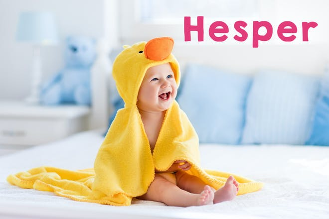 Smiling baby wearing a yellow duck cape