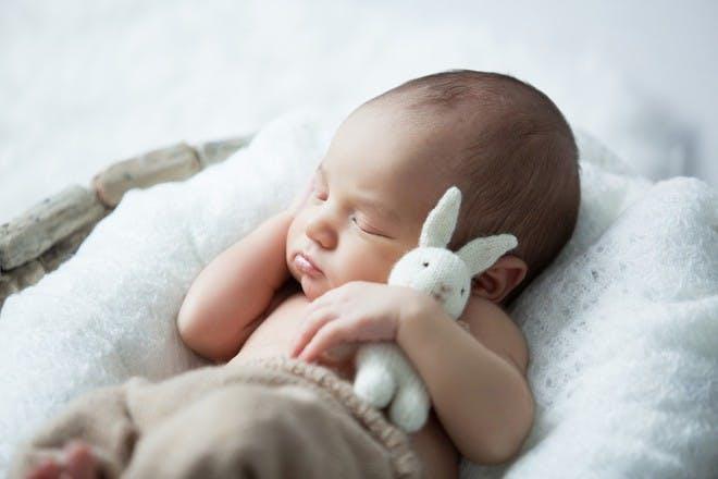 Baby sleeping with bunny