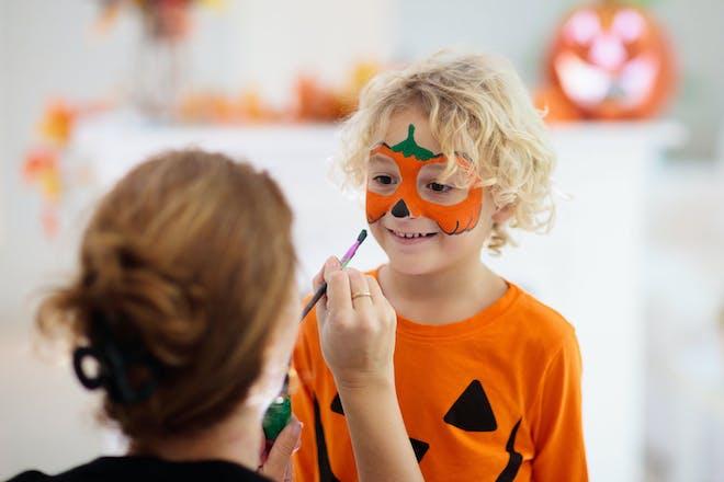 Little boy dressed as a pumpkin