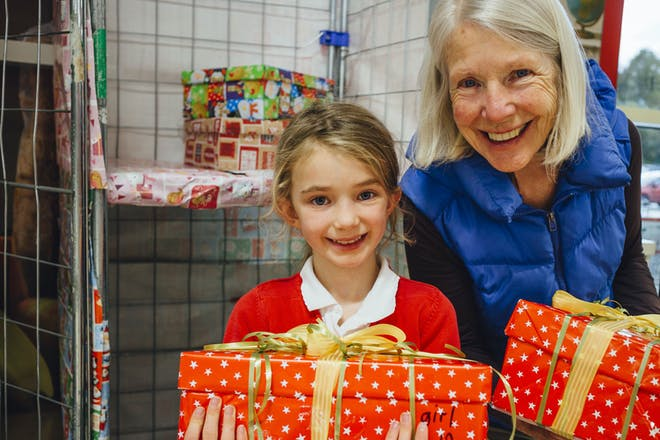 A child and her grandmother volunteering at Christmas