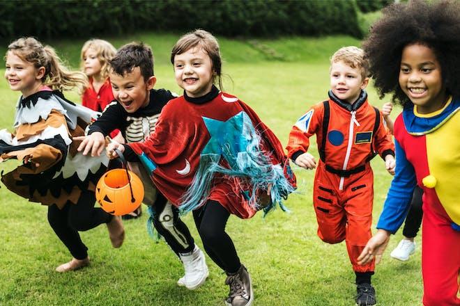 Kids running in Halloween costumes