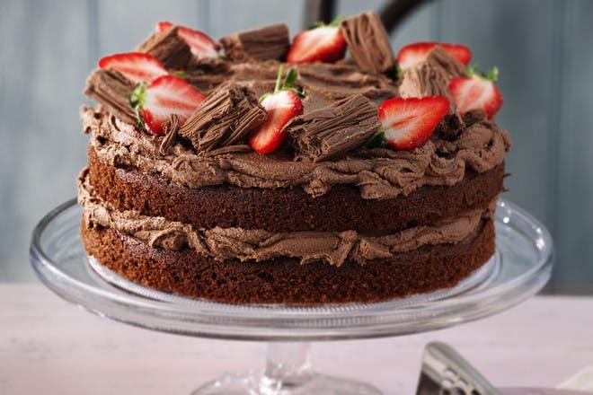 Classic chocolate cake recipe. Chocolate cake with chocolate icing and strawberries.
