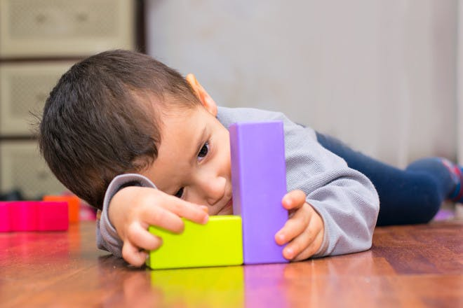 autistic child playing with bricks