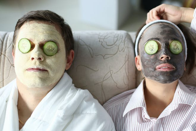 Couple relaxing with facemasks