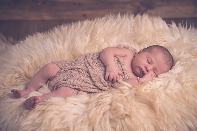 Baby lying on fur