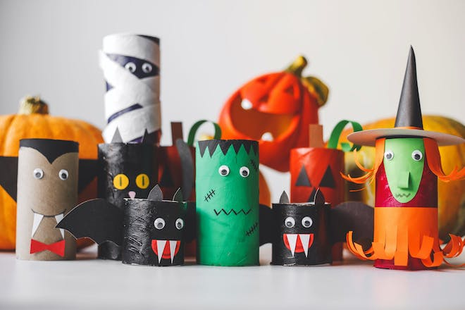 Cardboard toilet roll tubes turned into Halloween monsters by craft activity