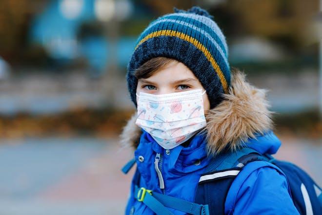 school boy wearing face mask