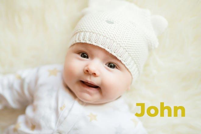 Baby wearing hat. Name John written in text