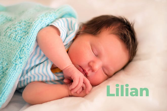 Sleeping baby with green blanket. Name Lilian written in text