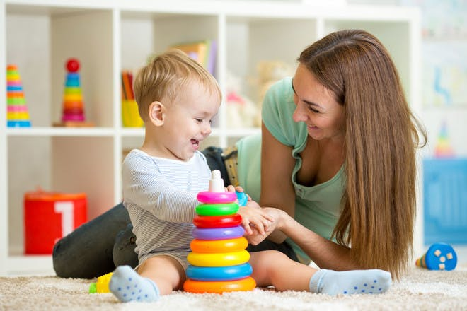 Woman playing with toddler