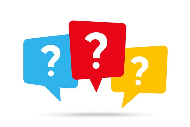 Three question marks in coloured speech bubbles