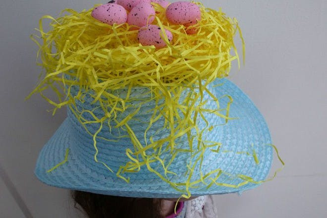 blue straw hat with nest decoration