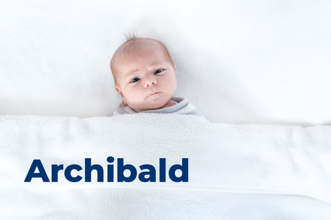 Baby looking inquisitive tucked under blanket. Name Archibald written in text