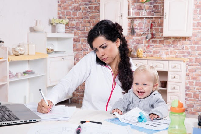 Mum working at home with toddler