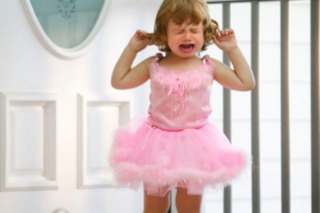 girl in pink tutu screaming