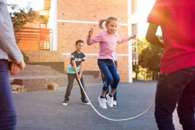 Children skipping in the playground