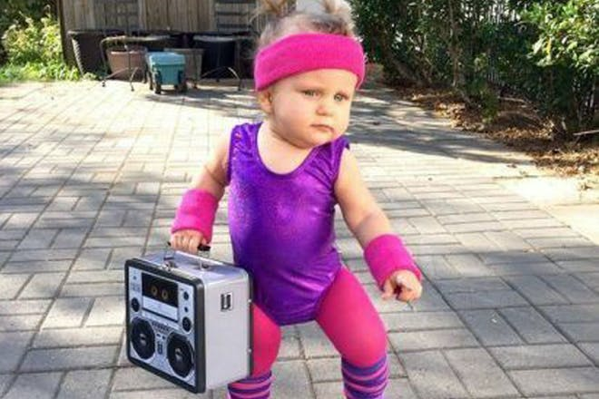 Child dressed in 80s inspired workout gear