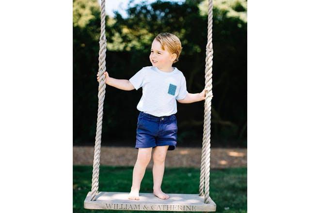 Prince George on a swing