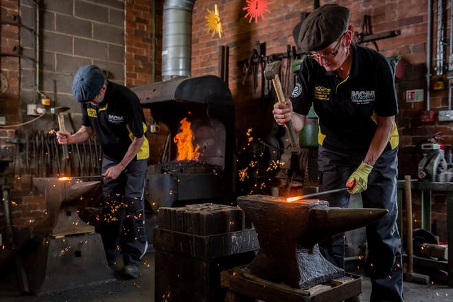 two blacksmiths working