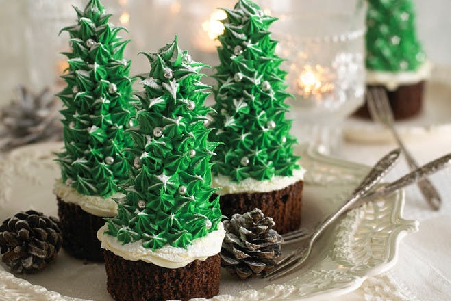 Christmas tree cupcakes recipe. These impressive Christmas tree bakes from Annabel Karmel are easier to make than they look. Try them with the kids