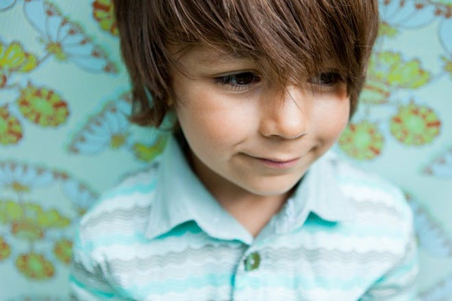 little boy in blue striped t shirt