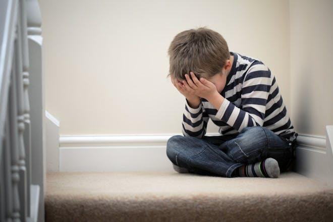 boy upset sitting on stair