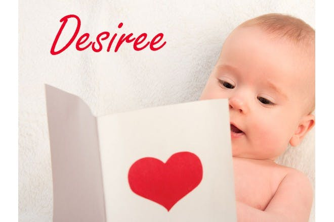 baby looking at card with heart on it