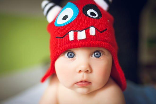 baby wearing funny hat