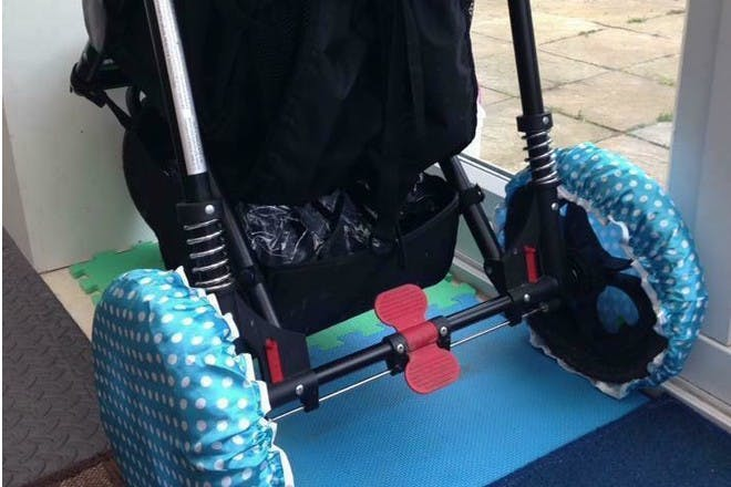 Pram with shower caps on wheels