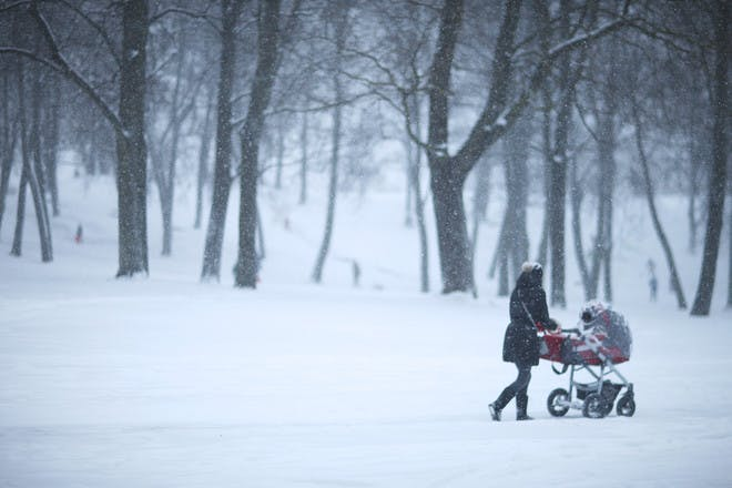 woman pushing buggy in snow