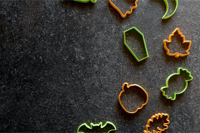 Halloween cookie cutters against grey background