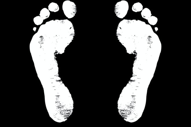 White footprint against black background