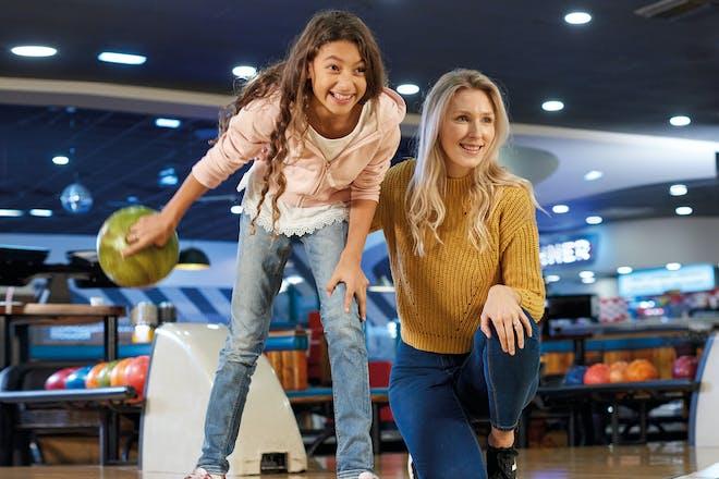 mum and daughter ten pin bowling