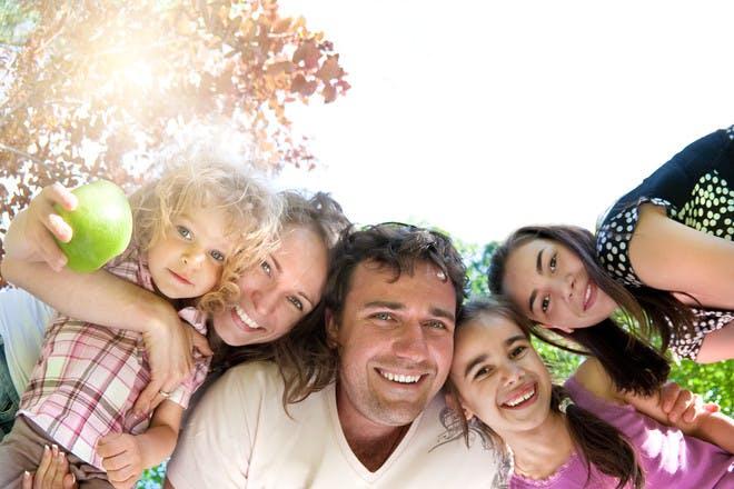 Happy family looking down at camera