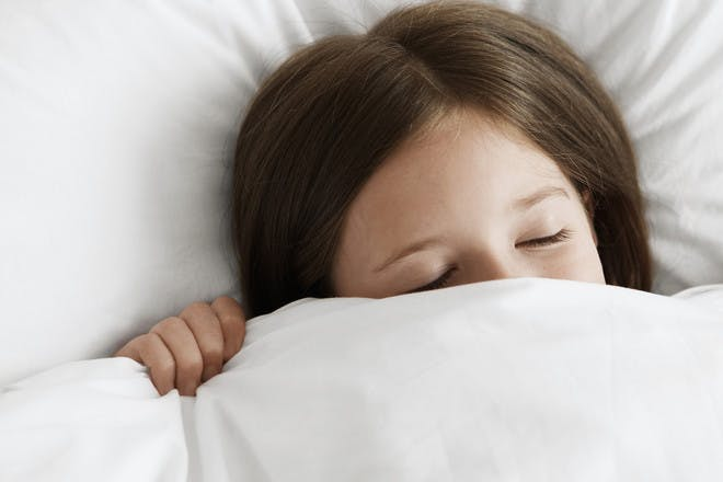 Girl asleep under duvet