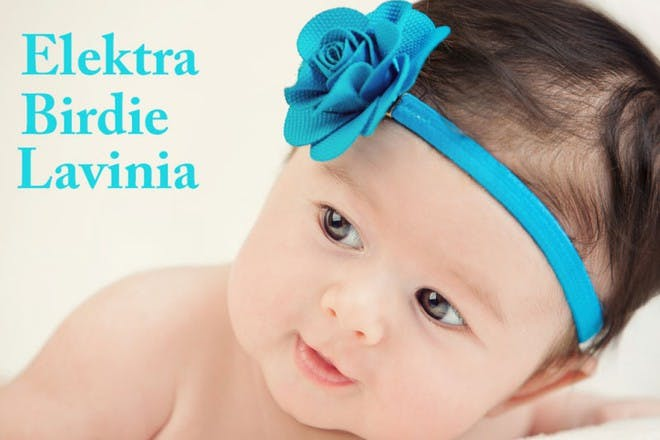 baby asian girl with blue flower headband