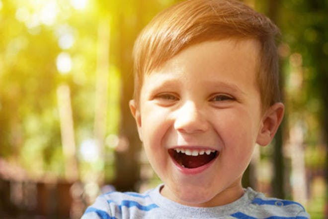 Boy smiling in woodland