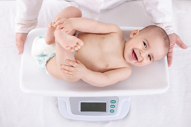 Baby being weighed