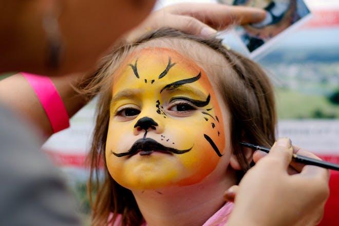 little girl facepainted tiger