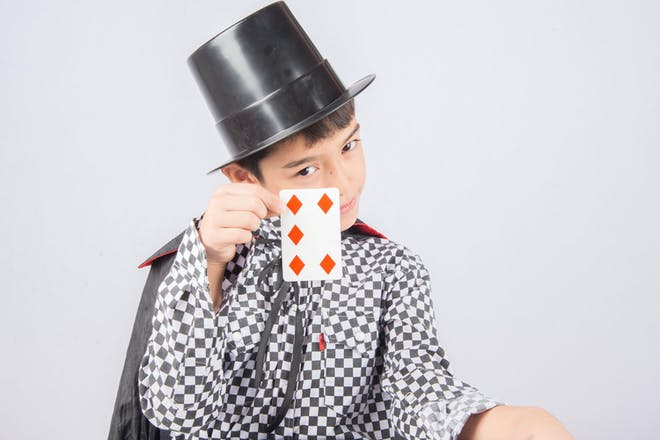 Boy dressed as a magician