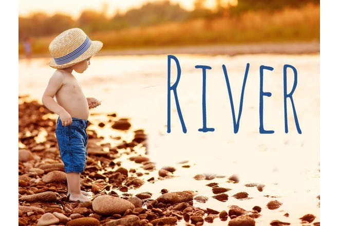 child standing next to river