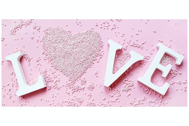 'Love' sign with a heart made from sweets