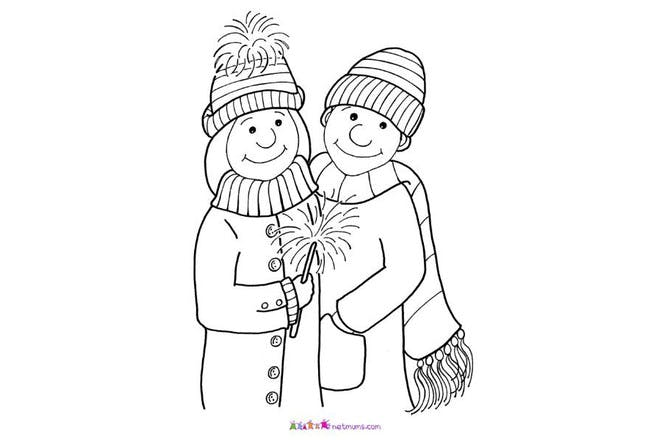 man and woman holding sparkler