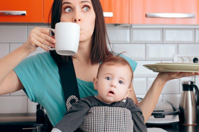 Mum juggling baby, food and tea